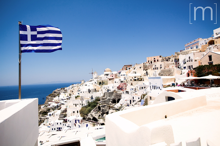 a travel photo of white houses in santorini greece