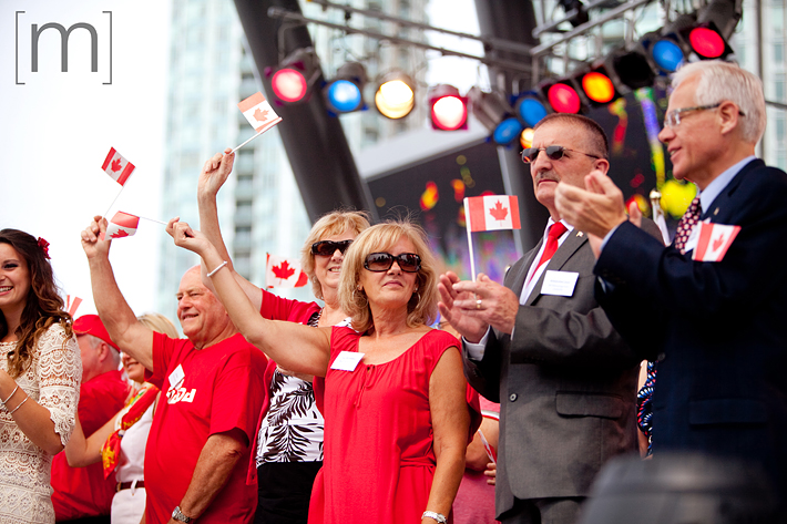 a photo of flags waving at a canada day event in mississauga
