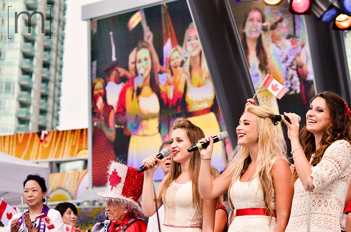 a photo of singers national anthem at a canada day event in mississauga