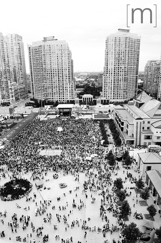 a photo of the crowd in the square at a canada day event in mississauga