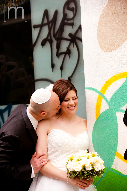 a photo of a bride and groom in kensington market toronto