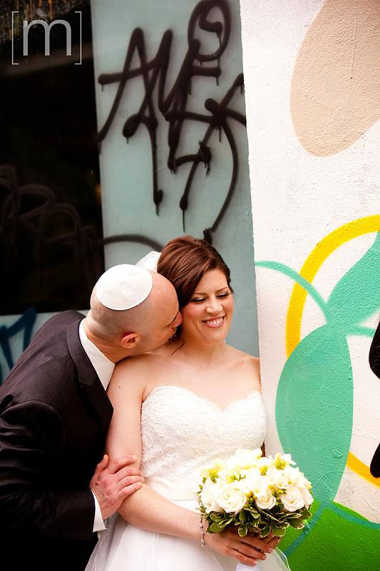 a photo of a bride and groom in kensington market toronto