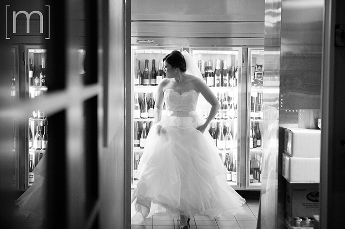 a photo of a bride in the kitchen in pangaea restaurant toronto