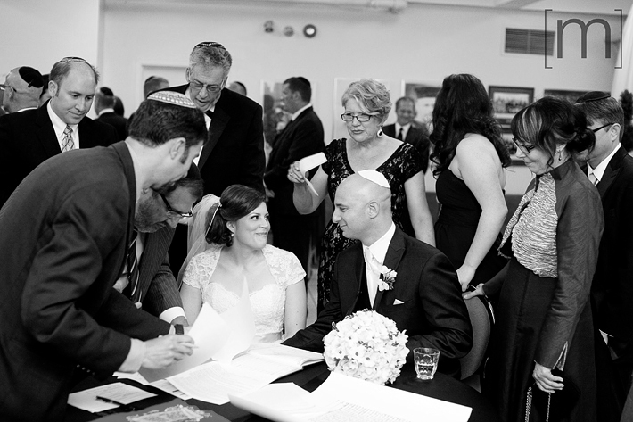 a photo of the jewish ceremony ketubah signing at kiever shul toronto