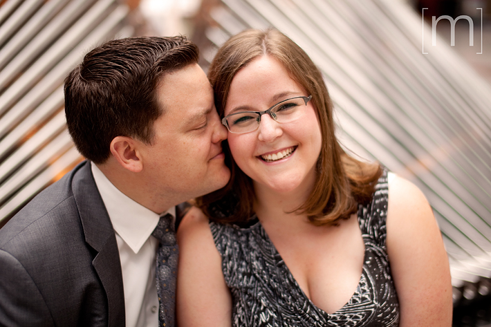 a photo of a couple snuggling at an engagement shoot at bce place in toronto