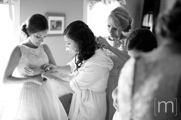 a photo of a bride getting ready at a wedding in uxbridge