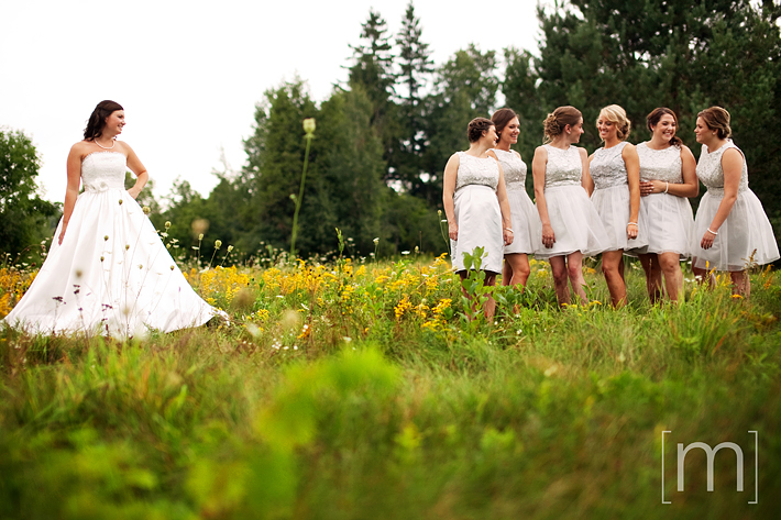 a photo of bridesmaids in a field at a wedding in uxbridge