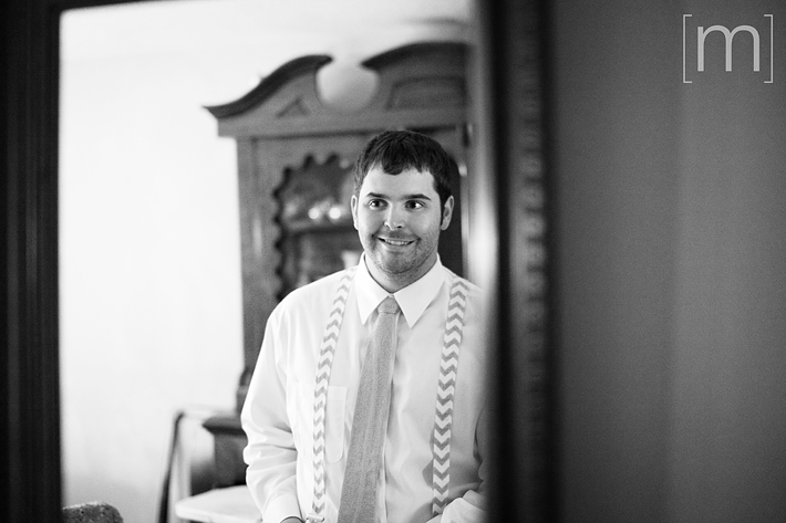 a photo of the groom getting ready at a wedding in uxbridge