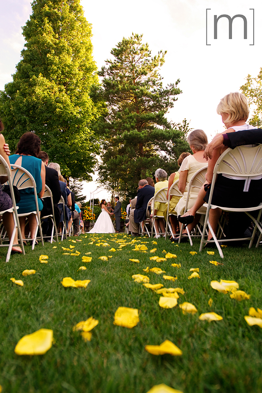 a photo of the outdoor ceremony at a wedding at wooden sticks uxbridge