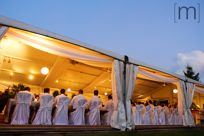 a photo of the reception under a tent at a wedding at wooden sticks uxbridge