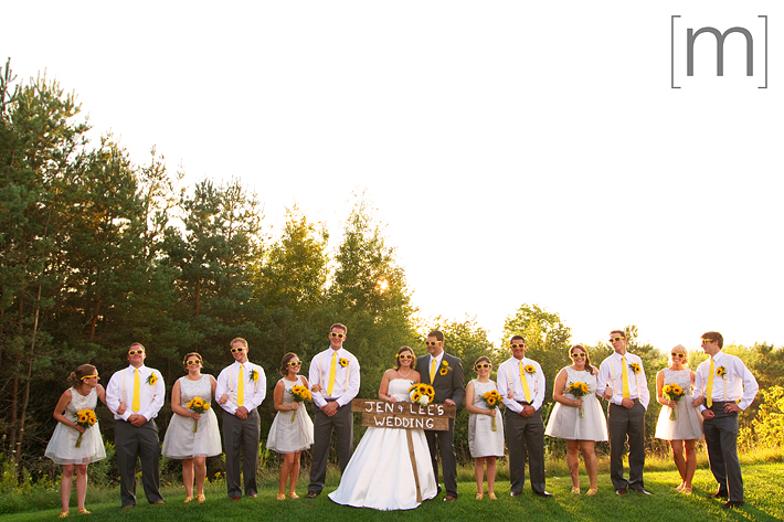 a photo of a yellow wedding party at sunset at wooden sticks uxbridge