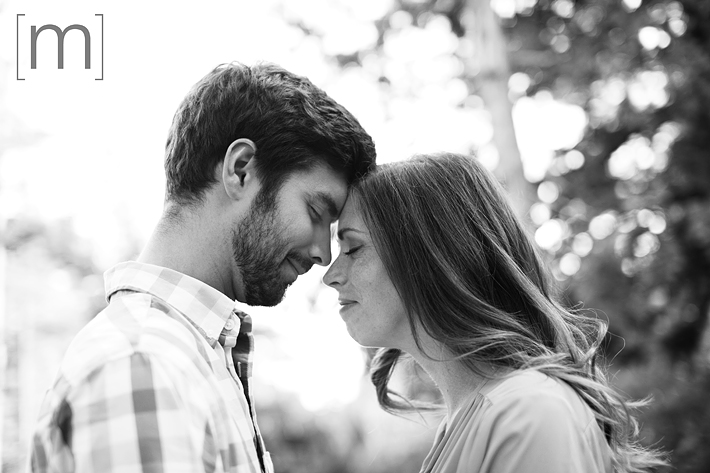 a photo of a couple cuddling at an engagement shoot in rockwood