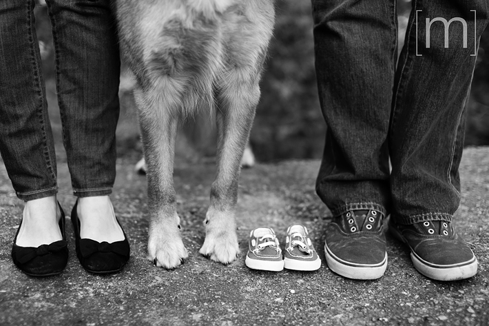 a photo of baby shoes and dog feet at an engagement shoot in rockwood
