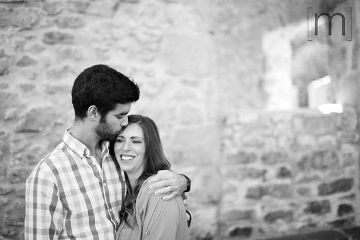 a photo of a couple kissing on forehead at an engagement shoot in rockwood