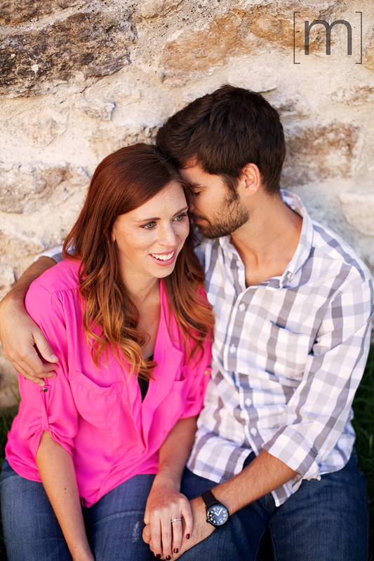 a photo of a couple against a wall at an engagement shoot in rockwood