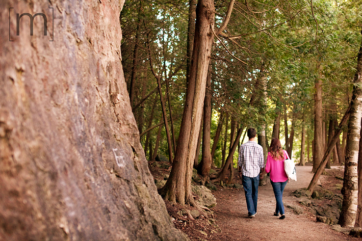 a photo of a couple walking at an engagement shoot in rockwood