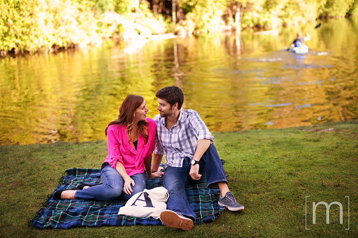 a photo of a couple having picnic at an engagement shoot in rockwood