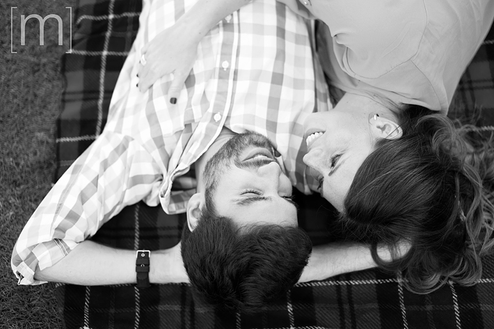 a photo of a couple laying down at an engagement shoot in rockwood