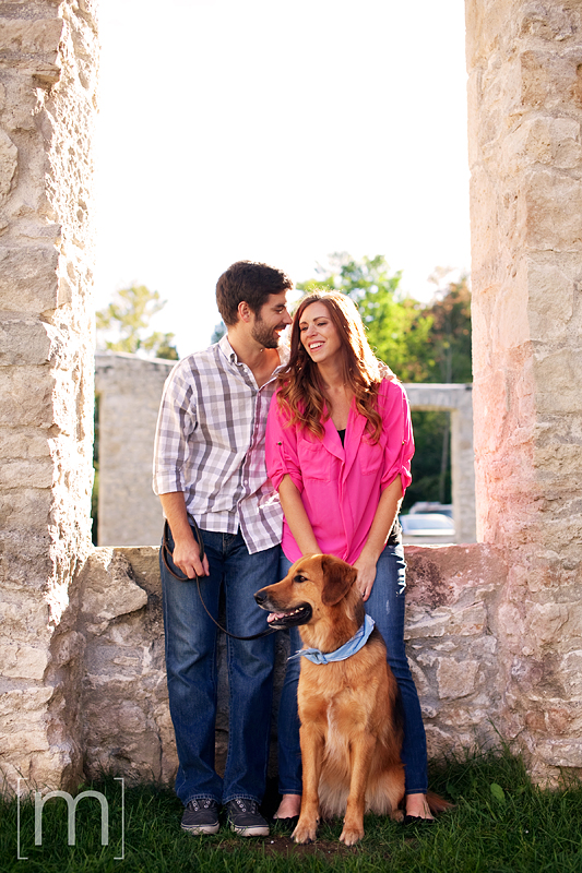 a photo of a couple laughing with dog at an engagement shoot in rockwood