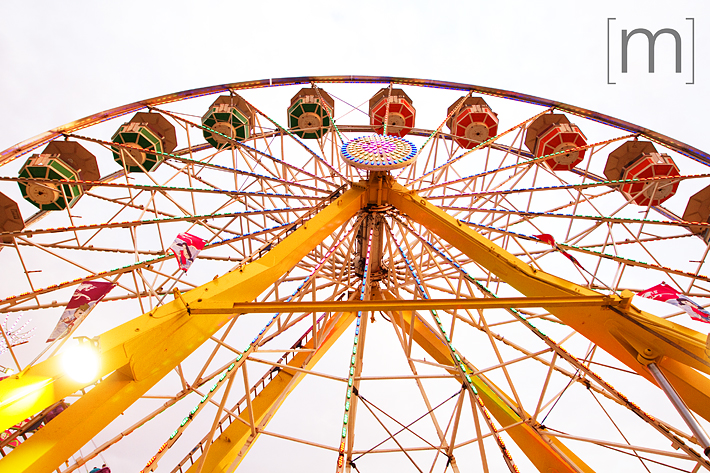a photo of a ferris wheel at an engagement shoot at the cne toronto