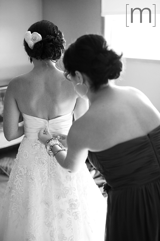 a photo of a bride getting ready at a wedding in niagara on the lake