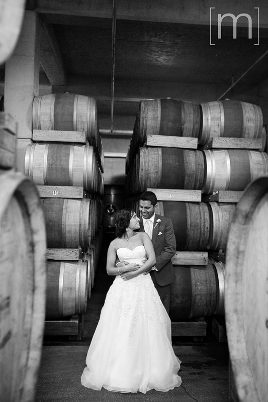 a photo of the couple in the wine cellar at a wedding in chateau des charmes niagara on the lake