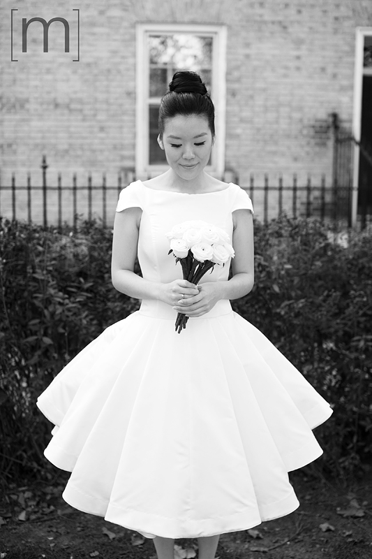 a photo of a bride at a wedding at the university of toronto
