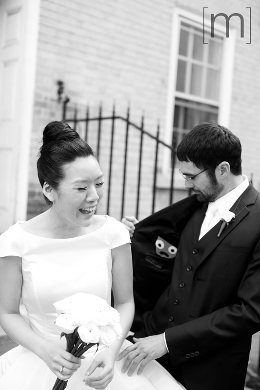 a photo of the cute couple at a wedding at the university of toronto