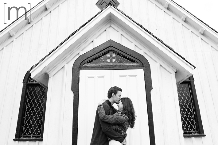 a photo of a couple kissing on the forehead at a fall engagement photoshoot in balls falls