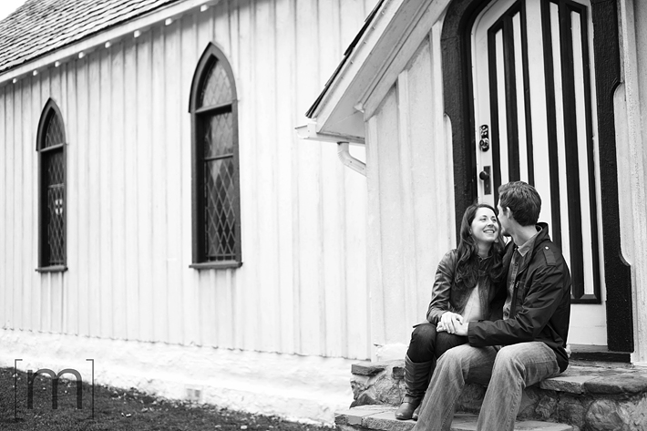 a photo of a couple sitting on old church steps at a fall engagement photoshoot in balls falls