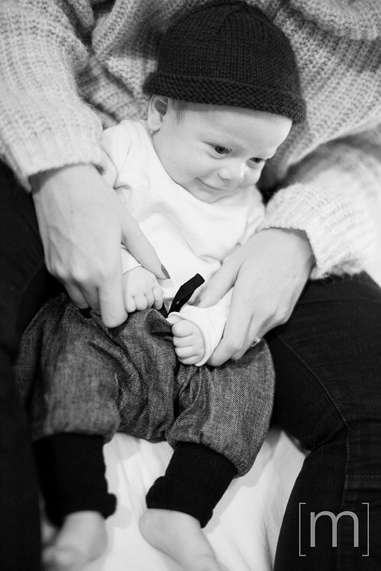 a photo of a smiling newborn at a family photoshoot in toronto