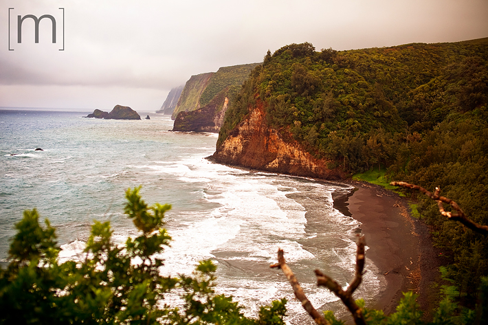 a travel photo of the big island black sands beach in hawaii