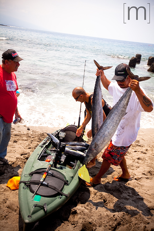 a travel photo of the big island fisherman with a catch in hawaii