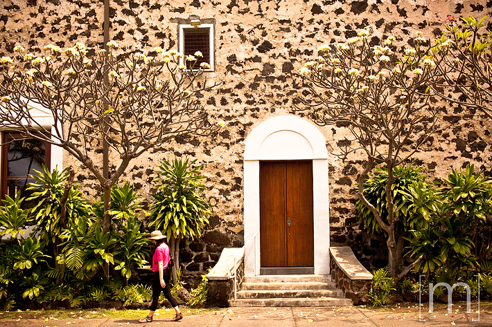 a travel photo of a church with a pretty garden in kona hawaii