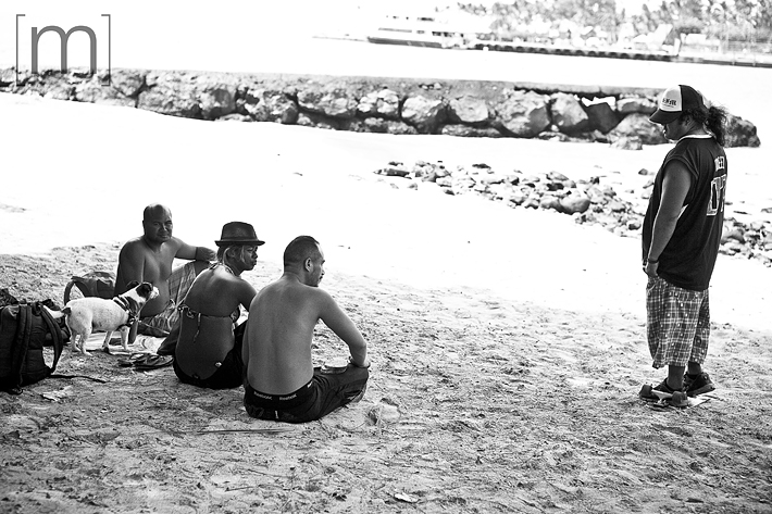 a travel photo of people on the beach in kona hawaii