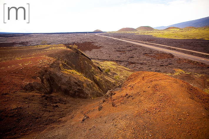 a travel photo of a colourful hillside in mauna kea hawaii