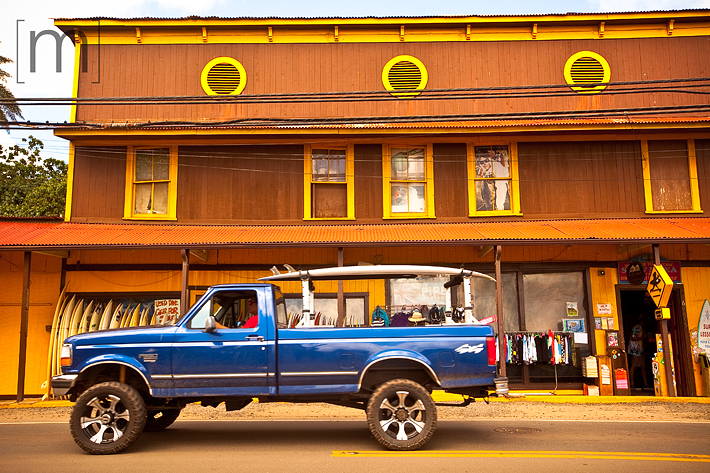 a travel photo of a truck with a surfboard on the northshore in oahu hawaii