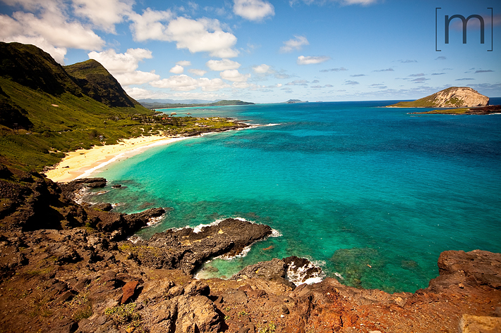 a travel photo of a turquoise beach in oahu hawaii