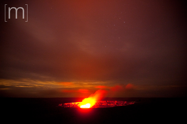 a travel photo of a volcano at night at volcano national park hawaii