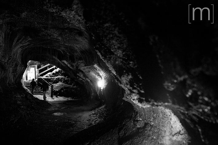 a travel photo of a lava tube at volcano national park hawaii