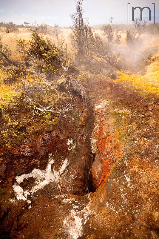 a travel photo of steam vents at volcano national park hawaii