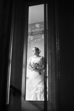 a photo of a bride through a vintage elevator at a wedding at the gladstone hotel toronto