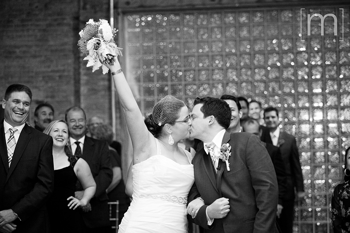 a photo of a wedding ceremony kiss at 99 sudbury toronto