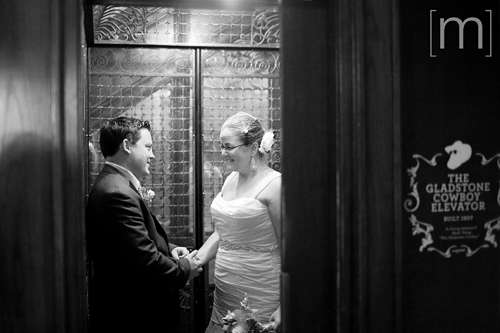 a photo of a couple in a vintage elevator at a wedding at the gladstone hotel toronto