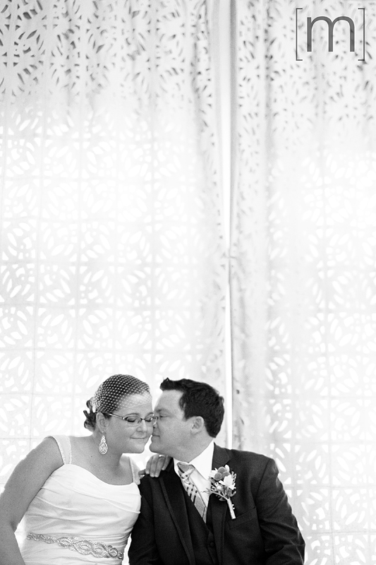 a photo of a couple kissing on the cheek at a wedding at the gladstone hotel toronto