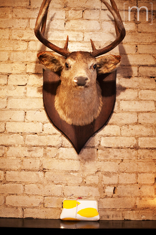 a photo of a deer head on a wall at a wedding at the gladstone hotel toronto