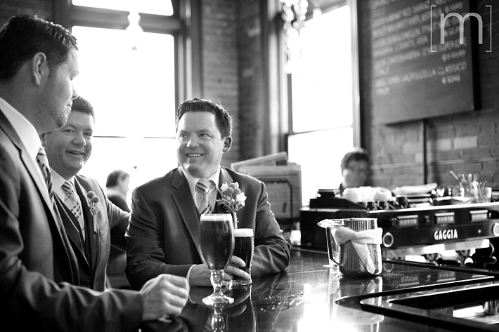 a photo of the groomsmen at the bar at a wedding at the gladstone hotel toronto