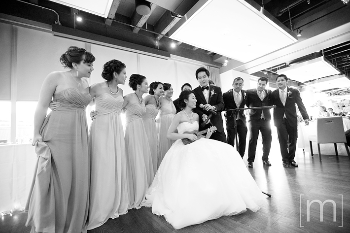 a photo of a bride playing the ukelele at a wedding at arcadian loft toronto