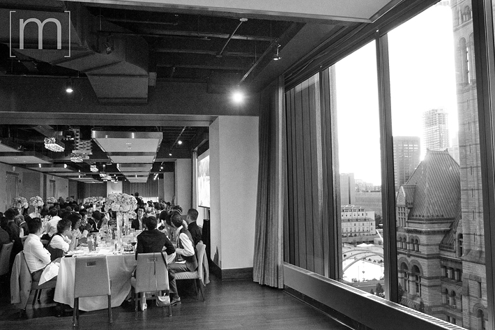 a photo of the guests at their tables at a wedding at arcadian loft toronto