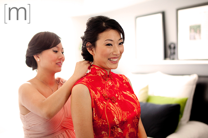 a photo of a bride in her Chinese dress at a wedding at arcadian loft toronto